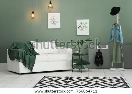 Cozy room interior with carpet on floor