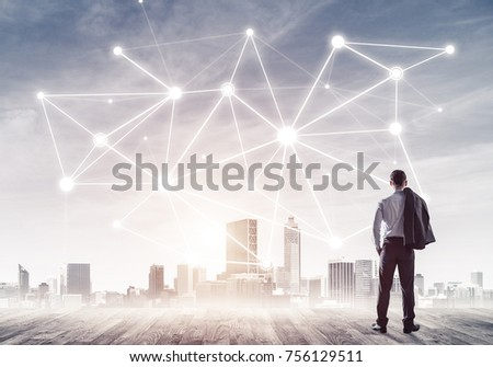 Businessman standing with back and looking at network drawn concept #756129511
