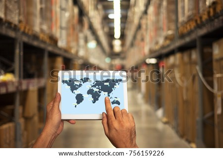 male manager hand holding tablet with AR application for check order pick time in smart factory warehouse, technology interface global partner connection for Logistic Import Export background #756159226