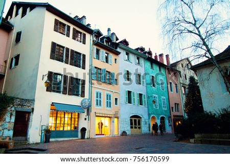 ANNECY, FRANCE - January 2015: Colorful buildings of old Annecy town in France on winter day. #756170599
