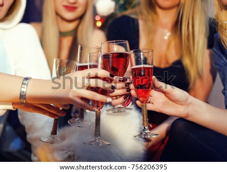 Cheers! Girls friends having xmas party and drinking red shampagne. Toasting with glasses of wine on the smiling womans backgroung. New year party #756206395