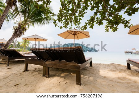 Summer landscape on tropical koh Kood island in Thailand. Landscape with sunbeds taken on Bang Bao beach. #756207196