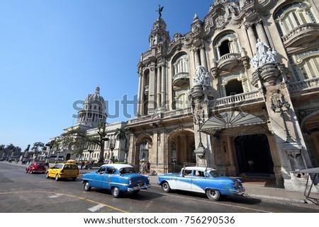 HAVANA, CUBA - FEBRUARY 27, 2011: People drive in Havana, Cuba. Cuba has one of the lowest car-per-capita rates (38 per 1000 people in 2008). #756290536