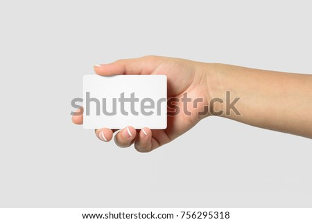 Mockup of female hand holding a Business Card isolated on light grey background. Rounded corner, size 85 × 55 mm.