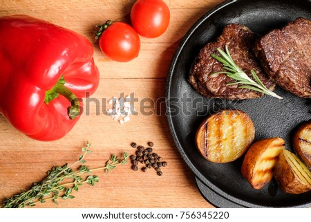 meat frying pan potatoes vegetables dish #756345220