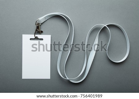 Blank badge mockup isolated on grey. Plain empty name tag mock up hanging on neck with string. #756401989