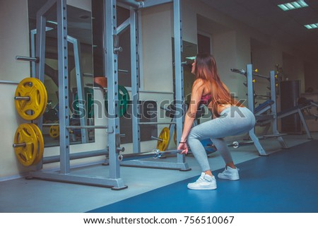picture of young brunette woman making exercise at the gym #756510067