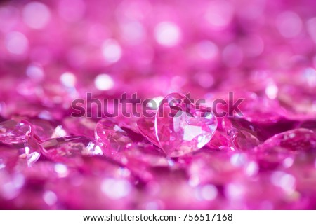 Many pink little crystal hearts with bokeh background. Romantic card on St. Valentine's Day. #756517168