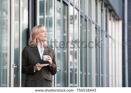 Having a coffee break outside the office #756518443