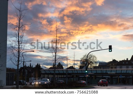 traffic lights and facades near train station at sunset time in autumn november in south germany near cities of munich and stuttgart #756621088