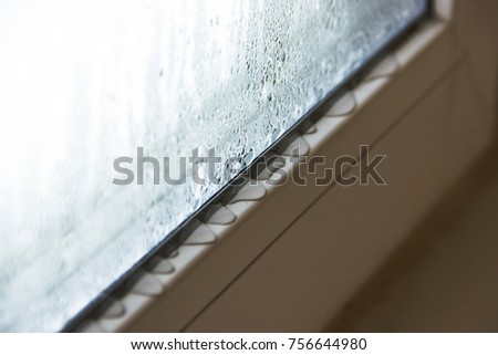 Defective plastic window with condensation Royalty-Free Stock Photo #756644980