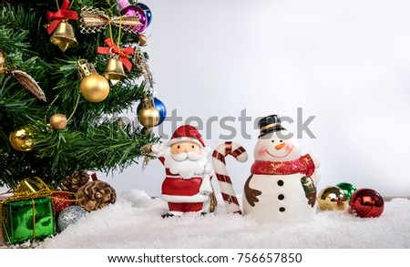 Christmas decoration Holiday or new year with Santa Claus and snowman on snow background and copy space. #756657850