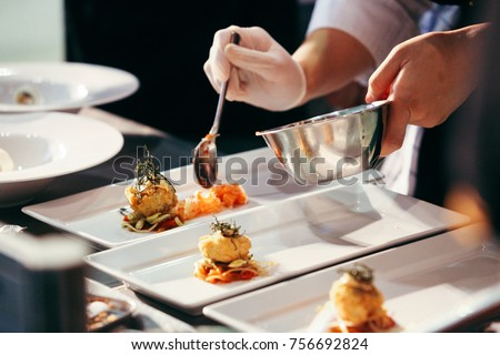 Chef preparing food, meal, in the kitchen, chef cooking in kitchen, Chef decorating dish, closeup Royalty-Free Stock Photo #756692824