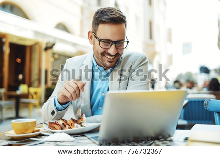 Businessman having breakfast and doing his work in cafe. #756732367