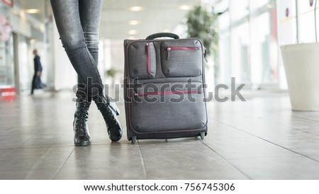 Passenger waiting  at the airport with suitcase #756745306