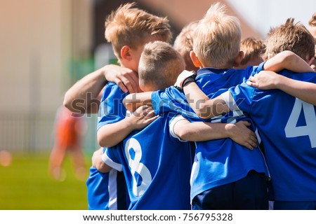 Kids Play Sports. Children Sports Team United Ready to Play Game. Children Team Sport. Youth Sports For Children. Boys in Sports Uniforms. Young Boys in Soccer Sportswear Royalty-Free Stock Photo #756795328