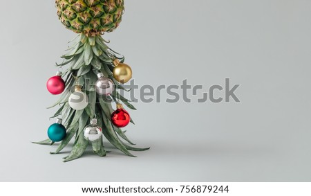 Christmas tree made of pineapple and christmas bauble decoration. Holiday concept. #756879244