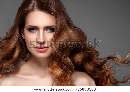 Beautiful hair woman beauty skin portrait over dark background. Long beautiful healthy hair model girl stock image. Studio shot. #756890188