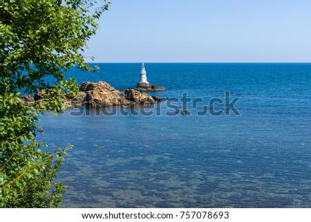 A lighthouse on the rocks. Black Sea. Ahtopol. Bulgaria. #757078693