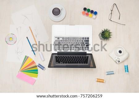 Fashion designer desk essentials top view with wooden texture background. #757206259