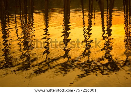 Sunset reflection on water to got the gold color from sun and was small wave on water and good dark shadow  #757216801