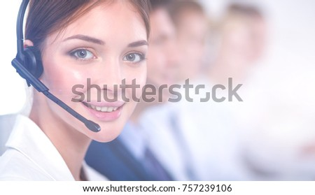 Attractive Smiling positive young businesspeople and colleagues in a call center office #757239106