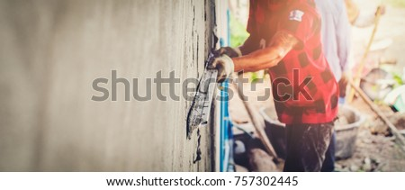 Blurred mason rural thailand Plastering concrete to build wall background industrial worker with plastering tools renovating house concept quality, professional of skilled labor construction industry #757302445