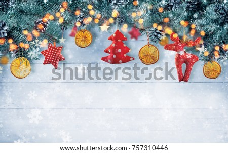 Christmas background with hand made cloth decorations. Free space for text. Celebration and decorative design, high resolution image