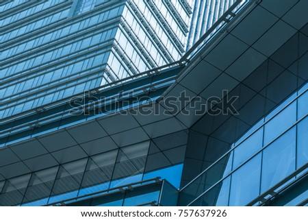 closeup of glass wall of modern building #757637926