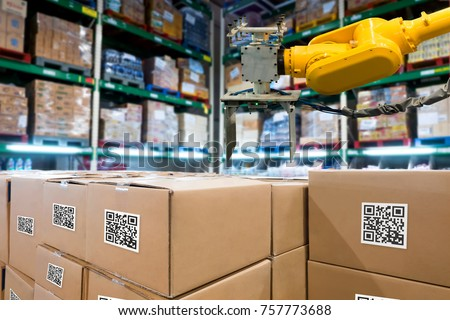 Smart logistic industry 4.0 , QR Codes Asset warehouse and inventory management supply chain technology concept. Group of boxes and Automation robot arm machine in storehouse. #757773688