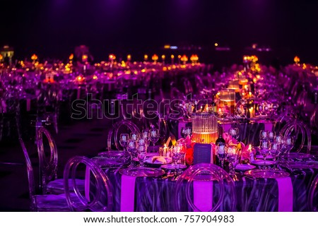 Christmas lights and decorations for a party event or gala dinner with candles and lamps Royalty-Free Stock Photo #757904983