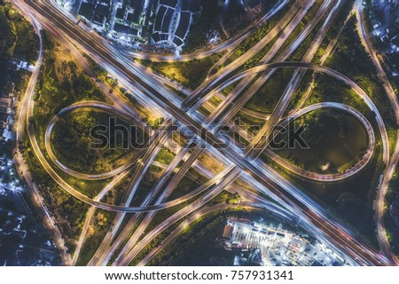 Top view over the highway, Controlled-access highway, the highest-grade type of highway with access ramps, lane dividers, etc., for high-speed traffic #757931341