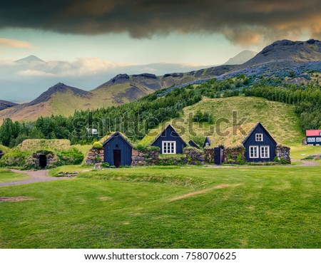 Typical view of Icelandic turf-top houses. Colorful summer morning in the Skogar village, south Iceland, Europe. Traveling concept background. Instagram filter toned.