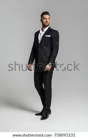 Portrait of handsome man in black suit Royalty-Free Stock Photo #758095231
