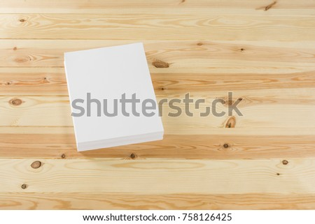 Mockup of magazine, poster, A4 brochure, catalog or flyer isolated on wooden background. Blank page top view for use in design, mockups and simulations. #758126425