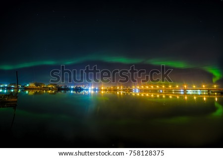 Polar lights above the city of Arkhangelsk. The Northern Dvina River and the bridge. Night view #758128375