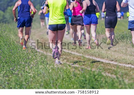 Group of young athlete running marathon outdoors #758158912