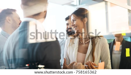 Collaboration and analysis by business people working in office Royalty-Free Stock Photo #758165362