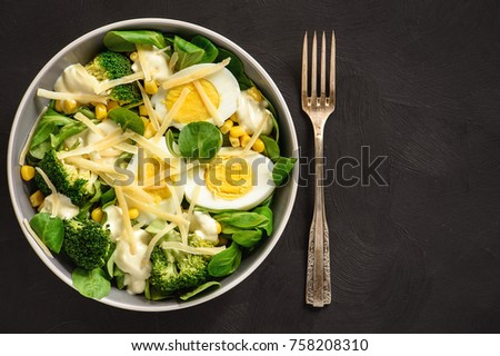 Healthy vegetarian salad with eggs, broccoli, corn and cheese #758208310