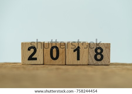 Cube wooden block with number 2018 as minimal 2018 new year calendar concept. #758244454