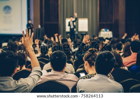 Speaker on the stage with Rear view of Audience in the conference hall or seminar meeting, business and education concept #758264113