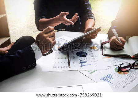 Business people using pen,tablet,notebook are planning a marketing plan to improve the quality of their sales in the future. Royalty-Free Stock Photo #758269021