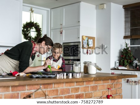 Mother and son baking for Christmas in the kitchen #758272789
