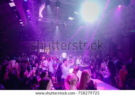 Odessa, Ukraine September 30, 2016: Night club dj party people enjoy of music dancing sound with colorful light, smoke machine, lights show and dance show. Hands up in the earth. #758279725