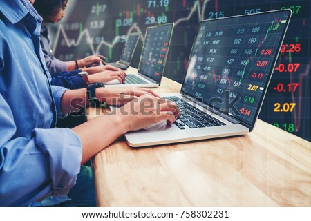 Business Team Investment Entrepreneur Trading working on Laptop Stock market exchange information and Trading graph #758302231