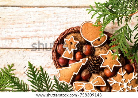 Christmas homemade gingerbread cookie in a wicker basket. Christmas and new year card. with free text space #758309143