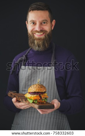 Smiling Man holding tray with chicken burger #758332603