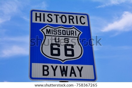 Historic route 66 highway sign in Missouri USA. Blue sky background #758367265