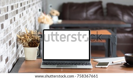 Laptop with blank screen on table. #758367661