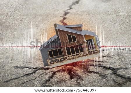 Earthquake crisis house risk insurance concept #758448097